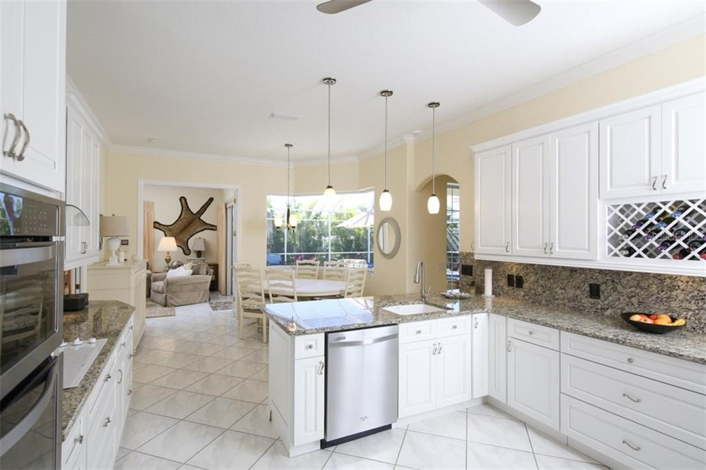 Open Kitchen to Dining Area - Single Family Home for sale at 15794 Viscount Cir, Port Charlotte, FL 33981 - MLS Number is D5916496