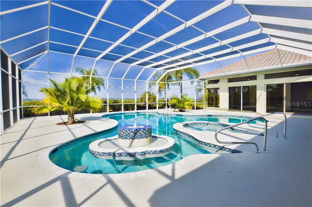 Nice pool area overlooking the Myakka River with 6 sliders opening into the pool area. - Single Family Home for sale at 3121 Rivershore Ln, Port Charlotte, FL 33953 - MLS Number is D5917816