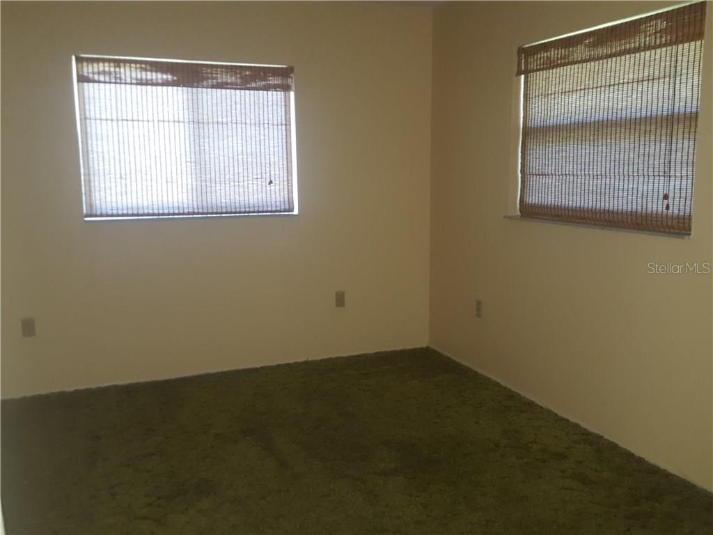 Rear bedroom now unfurnished.  This bedroom opens to the living area with sliding glass doors. - Single Family Home for sale at 21068 Halden Ave, Port Charlotte, FL 33952 - MLS Number is D5918749