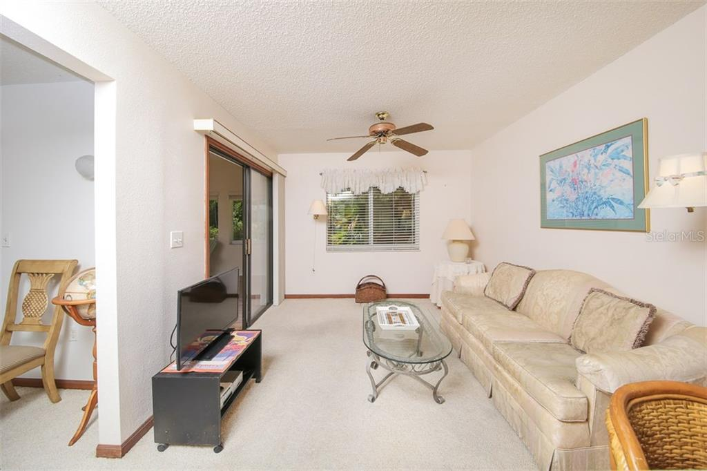 Family Room off Kitchen - Single Family Home for sale at 317 Indian River Ln, Englewood, FL 34223 - MLS Number is D5919375