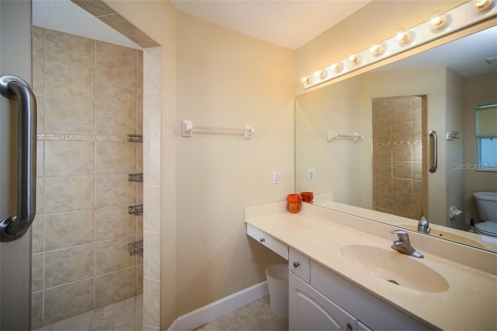 Master bath with large walk-in shower - Single Family Home for sale at 414 Tomoka Dr, Englewood, FL 34223 - MLS Number is D5919831