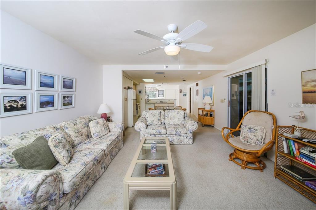 Living Room-Kitchen - Condo for sale at 9200 Little Gasparilla Is #203, Placida, FL 33946 - MLS Number is D5920072