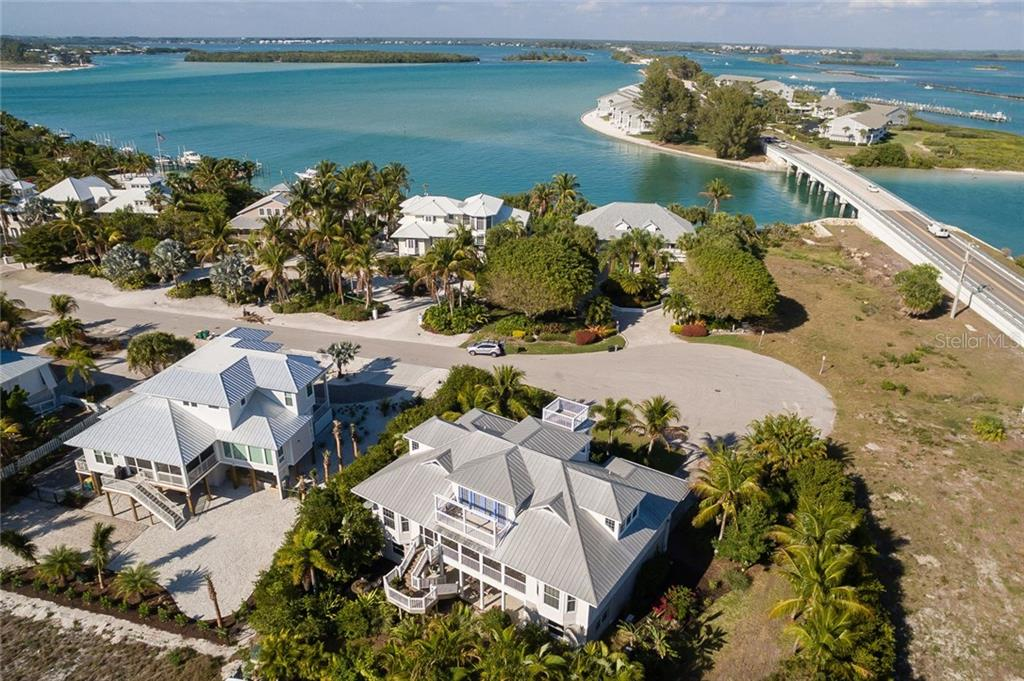 Aerial of property on end of cul-de-sac. - Single Family Home for sale at 9891 Gasparilla Pass Blvd, Boca Grande, FL 33921 - MLS Number is D5920572