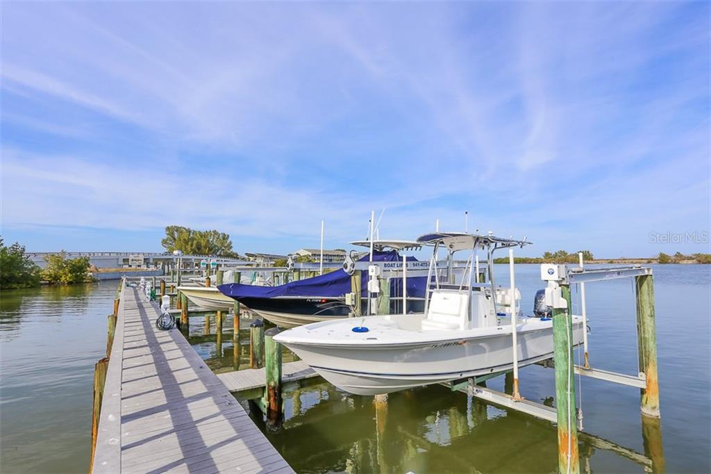 Community dock looking north - Single Family Home for sale at 16740 Grande Quay Dr, Boca Grande, FL 33921 - MLS Number is D5920860