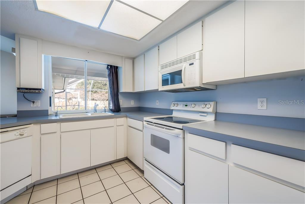 Bright and open kitchen - Single Family Home for sale at 11010 Deerwood Ave, Englewood, FL 34224 - MLS Number is D5921766