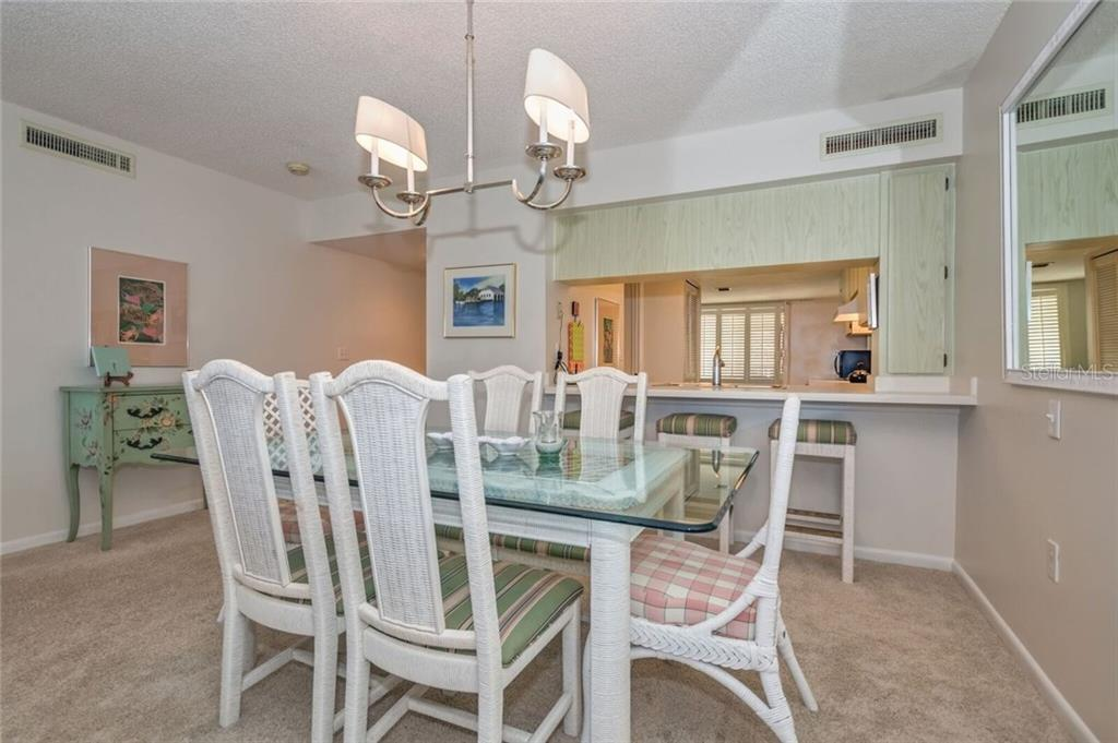 DINING AREA LOOKING INTO KITCHEN - Condo for sale at 5700 Gulf Shores Dr #a-215, Boca Grande, FL 33921 - MLS Number is D5922393