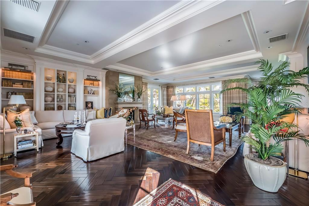 All season porch with handmade Portuguese tile and built-in grill - Single Family Home for sale at 16160 Sunset Pines Cir, Boca Grande, FL 33921 - MLS Number is D5922901