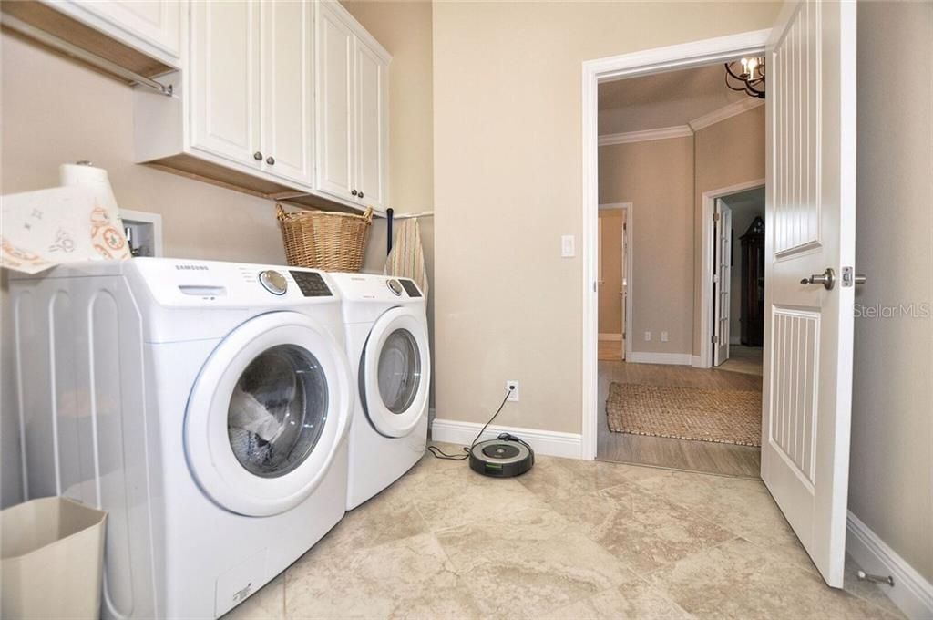 Laundry room - Single Family Home for sale at 8944 Scallop Way, Placida, FL 33946 - MLS Number is D5923173