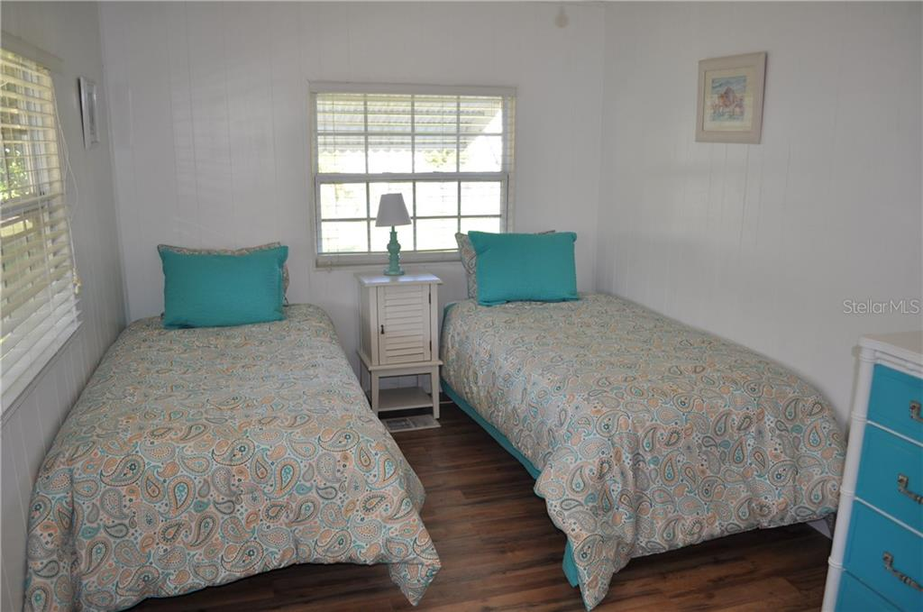 THIS IS THE GUEST BEDROOM.  NOTICE THE LOVELY LANINATE FLOORING. - Single Family Home for sale at 1586 Blue Heron Dr, Englewood, FL 34224 - MLS Number is D5923669