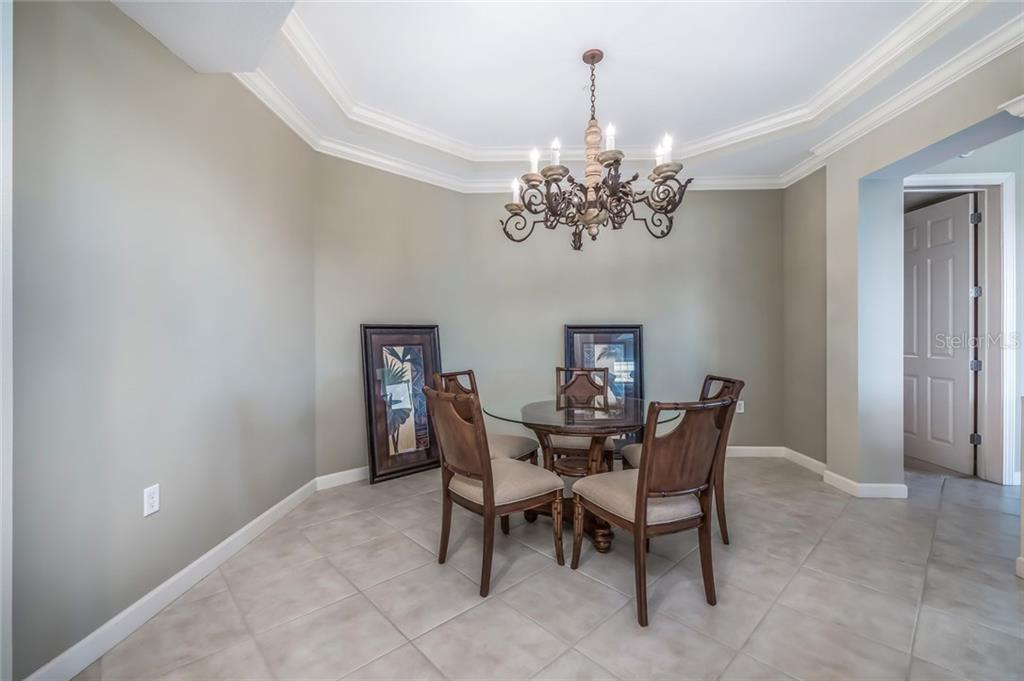 Formal dining space off of living room - this unit comes furnished. It is just waiting for you to make it your own showpiece! - Condo for sale at 8541 Amberjack Cir #402, Englewood, FL 34224 - MLS Number is D5923680