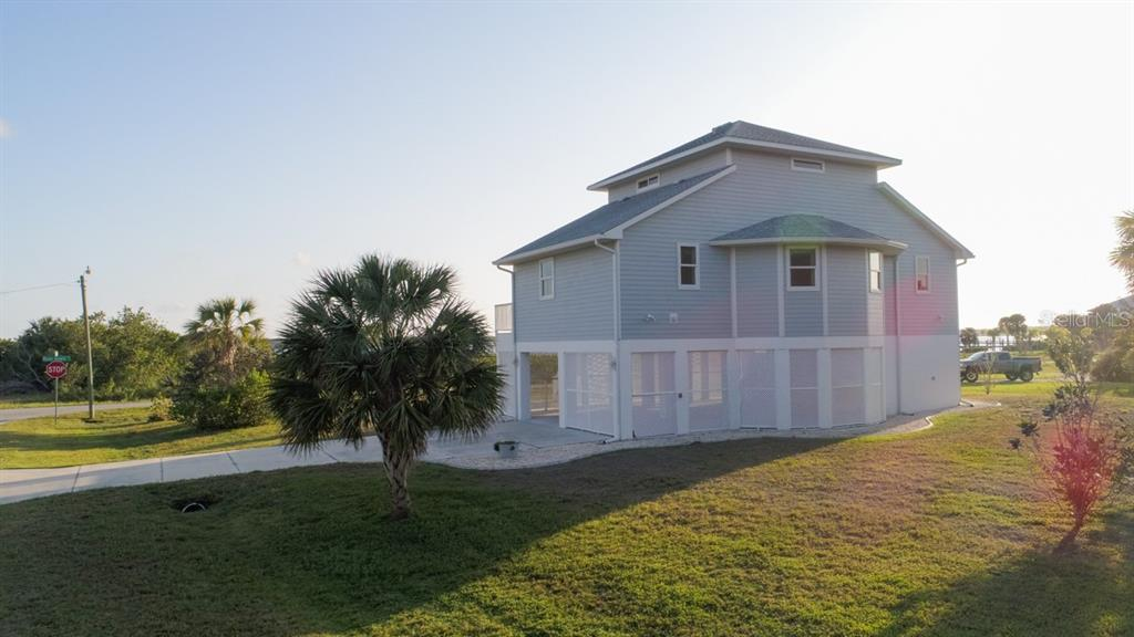 Side of Home - Single Family Home for sale at 14241 River Beach Dr, Port Charlotte, FL 33953 - MLS Number is D5924121