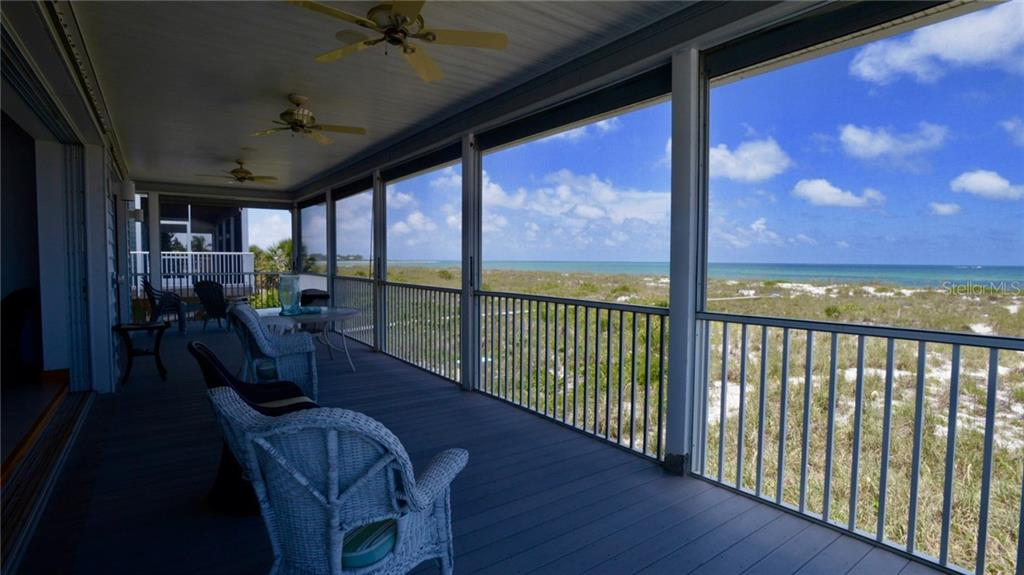 The oversized master bedroom has plenty of room for a king size bed.  In addition, there is another set of pocket doors for easy access out onto the lanai. - Single Family Home for sale at 9722 Little Gasparilla Is, Placida, FL 33946 - MLS Number is D6100685
