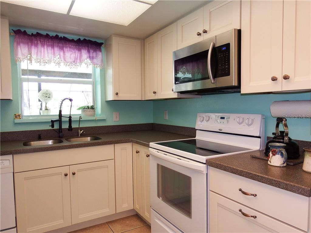 Kitchen updated with new Kraft Maid soft close cabinets, corian counter tops, commercial style faucet, under sink RO, new microwave, fresh paint, new plumbing. - Single Family Home for sale at 12 Oakland Hills Pl, Rotonda West, FL 33947 - MLS Number is D6100794