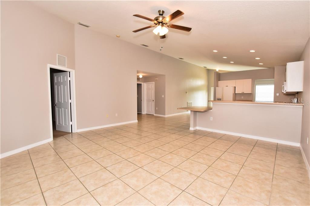 Great room looking toward the kitchen. - Single Family Home for sale at 4414 Callaway St, Port Charlotte, FL 33981 - MLS Number is D6100799