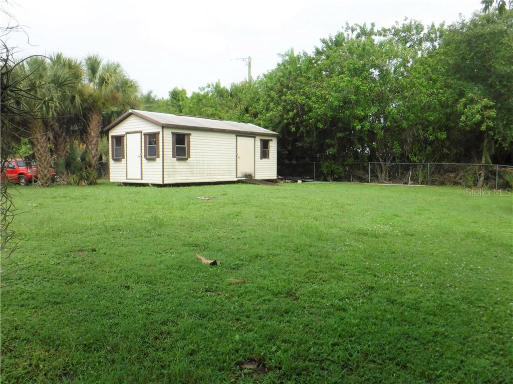 Shed in fenced-in back yard.  Look at the size of the yard. - Single Family Home for sale at 3001 Pellam Blvd, Port Charlotte, FL 33948 - MLS Number is D6101282