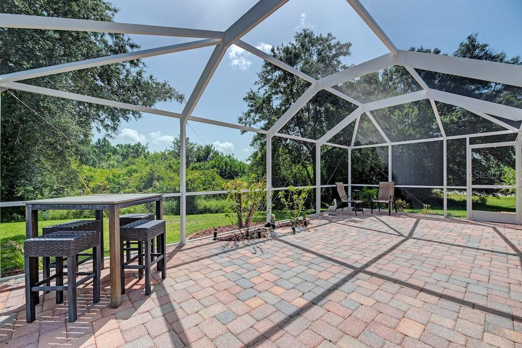 Large lanai with screen cage.  Perfect for entertaining! - Single Family Home for sale at 7256 Holsum St, Englewood, FL 34224 - MLS Number is D6101787