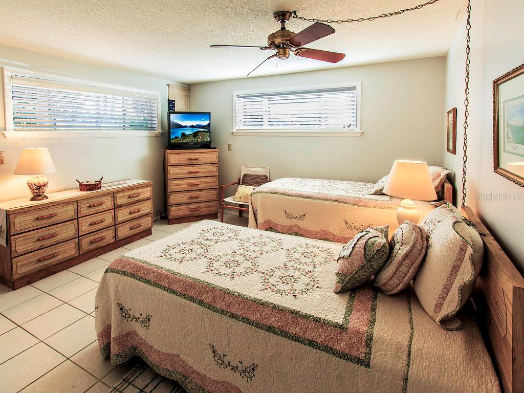Another angle of the 2nd bedroom en suite. - Condo for sale at 2980 N Beach Rd #c2-4, Englewood, FL 34223 - MLS Number is D6101944