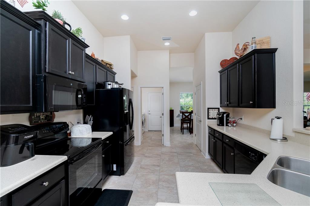 A true cook's kitchen with ample counter space and plentiful cabinetry. - Single Family Home for sale at 71 Mariner Ln, Rotonda West, FL 33947 - MLS Number is D6101950