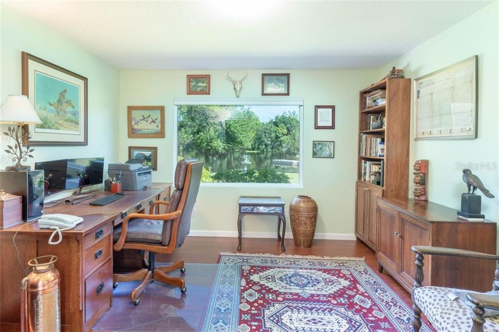 Originally a 4 bedroom home, the current owners converted 2 of the rooms for use as his and hers offices.  This office enjoys a stunning view of the pond and has a double framed opening as it access. - Single Family Home for sale at 7339 Hawkins Rd, Sarasota, FL 34241 - MLS Number is D6102762