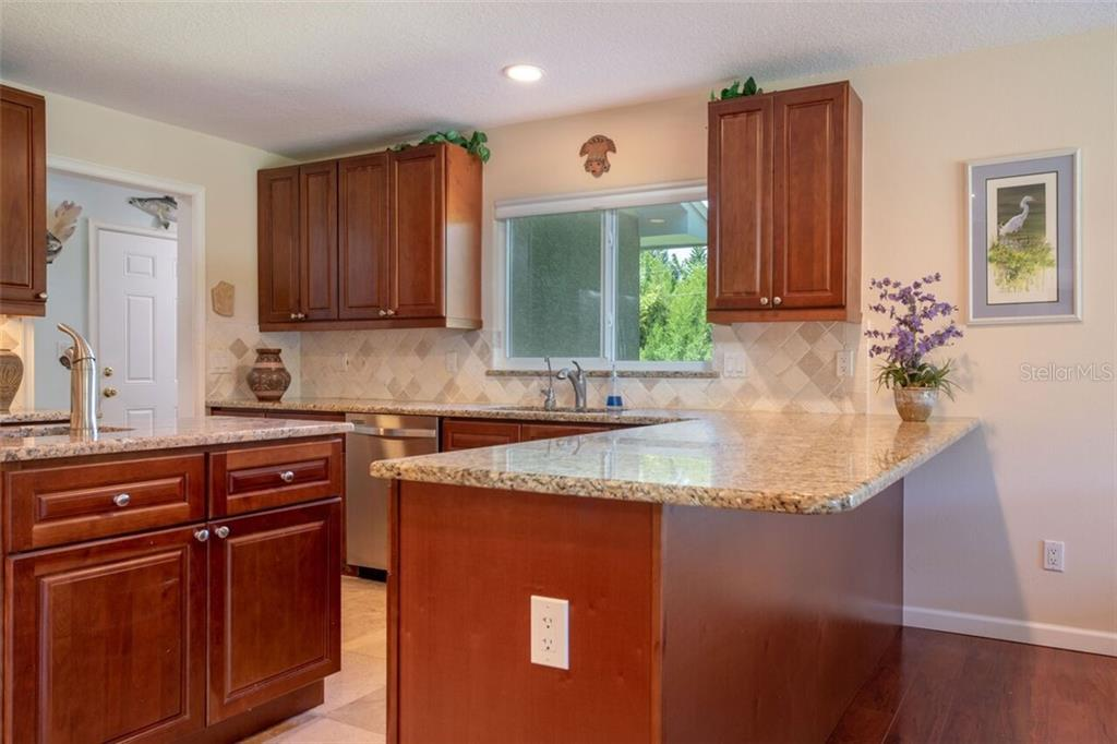 The large kitchen has counter seating for 3-4 people - Single Family Home for sale at 7339 Hawkins Rd, Sarasota, FL 34241 - MLS Number is D6102762