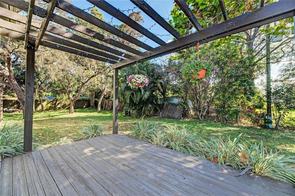 Freshly painted deck.  The perfect place to enjoy the wooded yard. - Single Family Home for sale at 3723 Shamrock Dr, Venice, FL 34293 - MLS Number is D6102893
