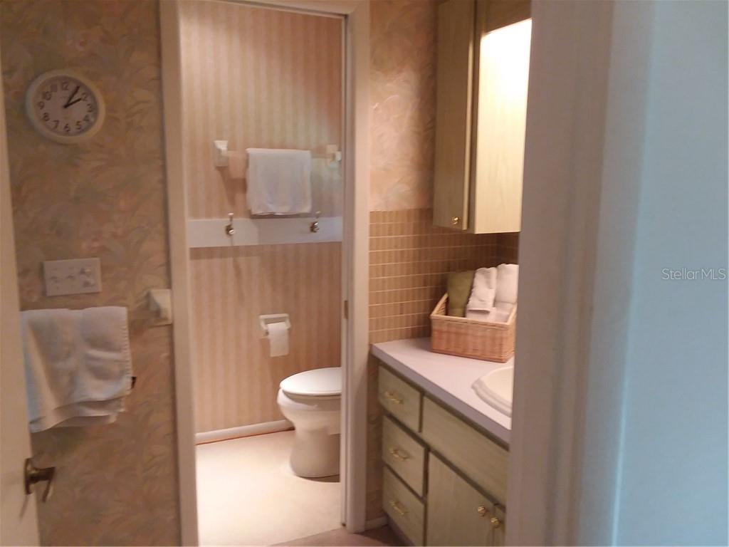 Ensuite in Master Bedroom - Single Family Home for sale at 7 Old Trail Rd, Englewood, FL 34223 - MLS Number is D6102912
