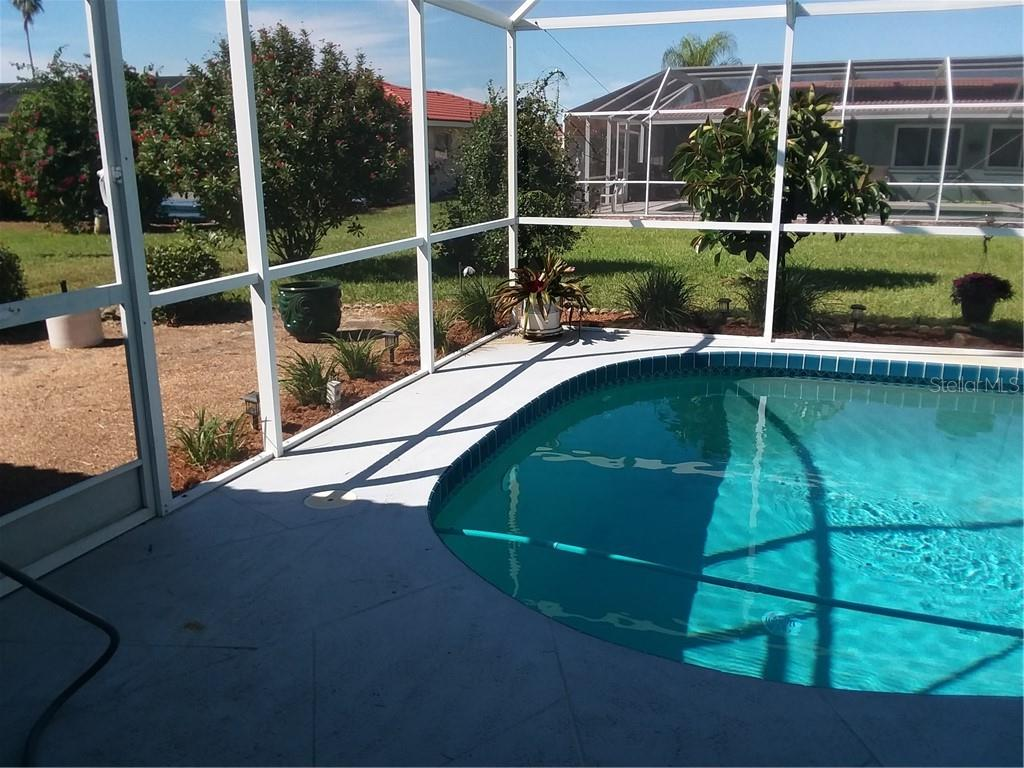 Garden area outside of pool - Single Family Home for sale at 7 Old Trail Rd, Englewood, FL 34223 - MLS Number is D6102912