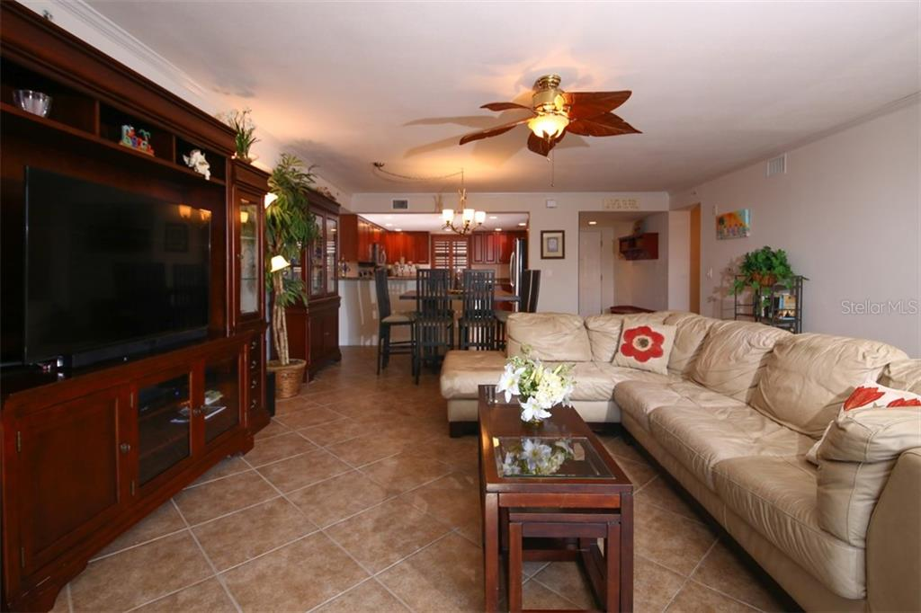 Living/Dining Area Opens to Kitchen - Condo for sale at 50 Meredith Dr #8, Englewood, FL 34223 - MLS Number is D6103644