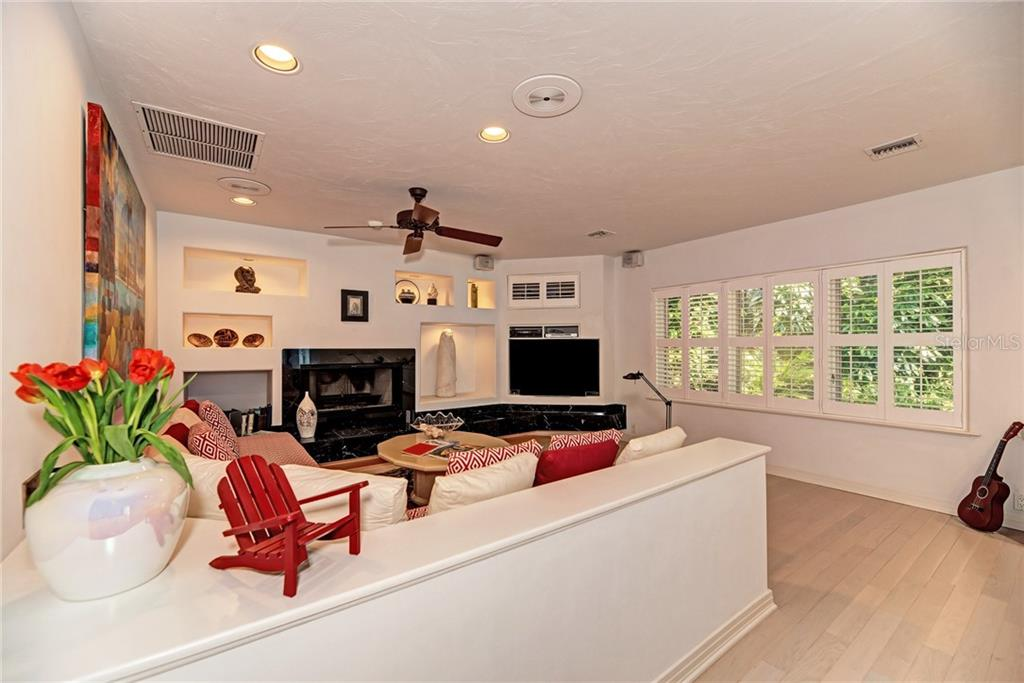 Decor in the display cases will remain with the house. Snuggle up in front of the wood burning fireplace or watch a movie. - Single Family Home for sale at 7400 Manasota Key Rd, Englewood, FL 34223 - MLS Number is D6104362