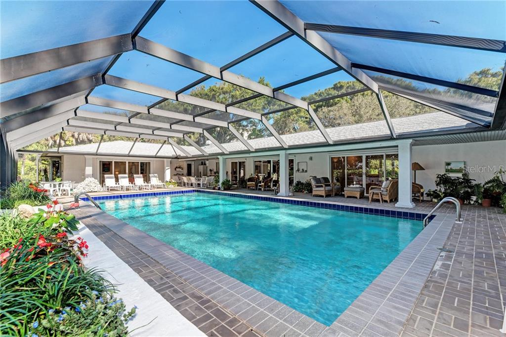 Geo-thermal heating keeps the pool warm even in the coolest days of winter. - Single Family Home for sale at 7400 Manasota Key Rd, Englewood, FL 34223 - MLS Number is D6104362