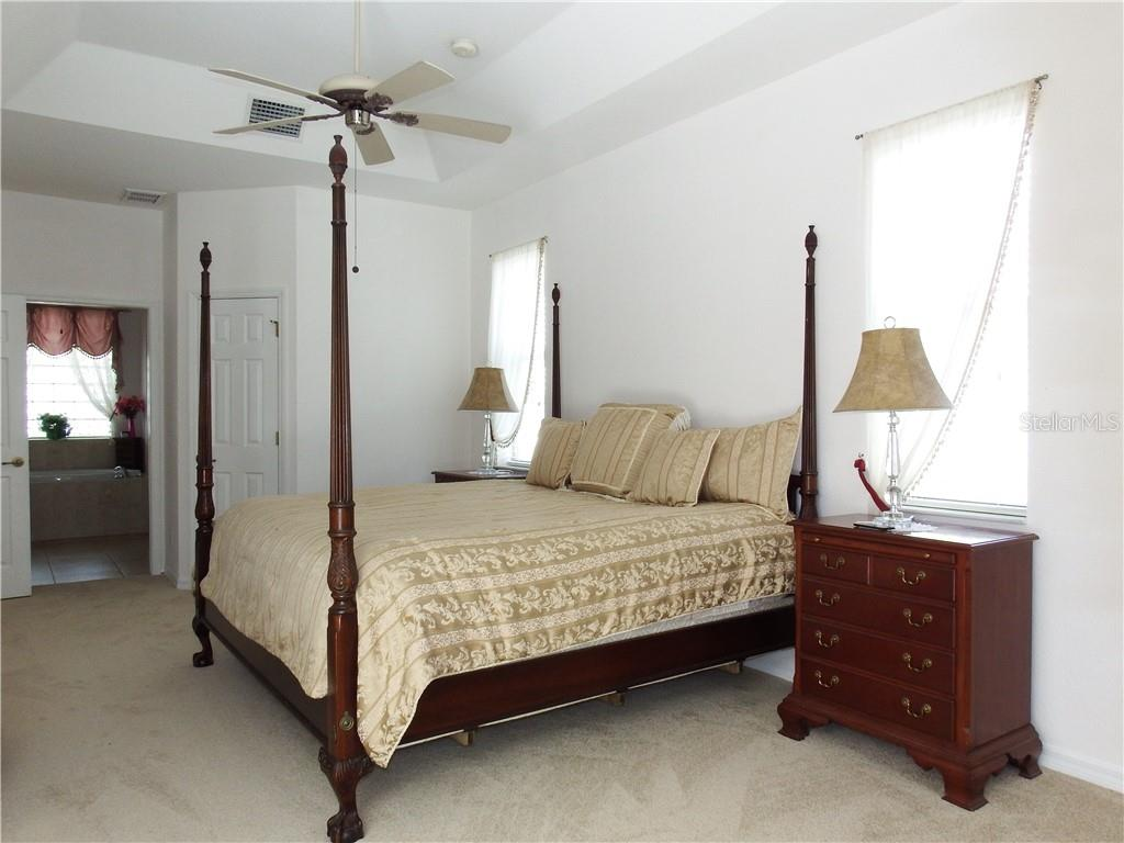 Master Bedroom suite with sliding doors to the Lanai and pool area. - Single Family Home for sale at 8 Medalist Cir, Rotonda West, FL 33947 - MLS Number is D6104474