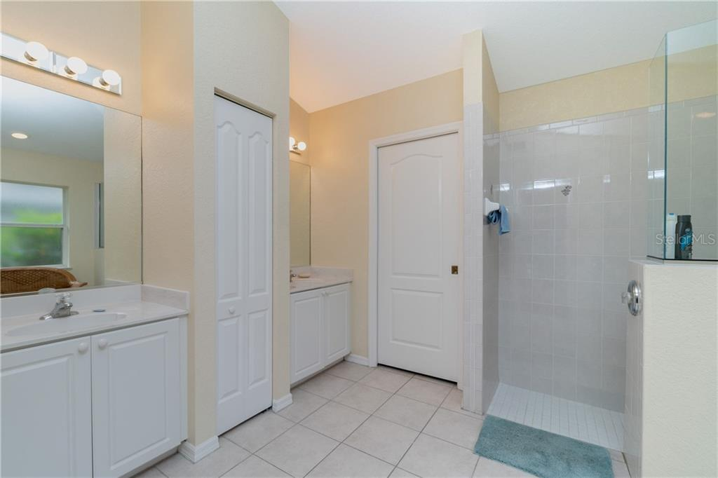 Master bath has a Roman shower and tiled flooring. - Single Family Home for sale at 30 Medalist Way, Rotonda West, FL 33947 - MLS Number is D6106239