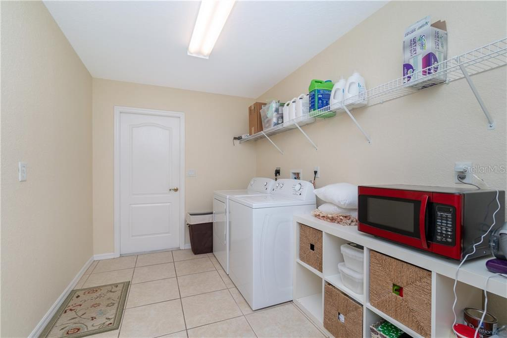 Inside Laundry has Kenmore washer/dryer & tiled flooring. - Single Family Home for sale at 30 Medalist Way, Rotonda West, FL 33947 - MLS Number is D6106239