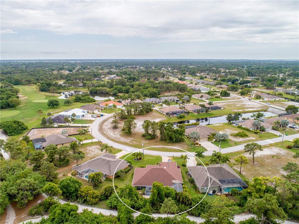 An aerial view of the rear of the property and surrounding neighborhood of Medalist Way. - Single Family Home for sale at 30 Medalist Way, Rotonda West, FL 33947 - MLS Number is D6106239