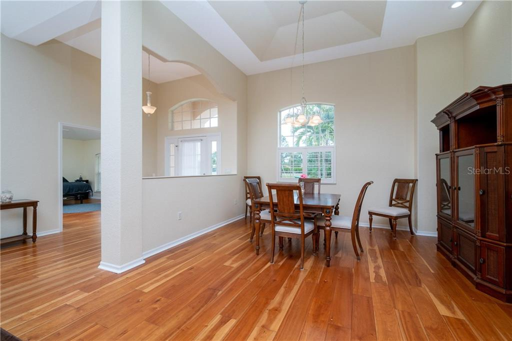 Formal Dining Room has tray ceiling and is open to all main living areas. - Single Family Home for sale at 30 Medalist Way, Rotonda West, FL 33947 - MLS Number is D6106239