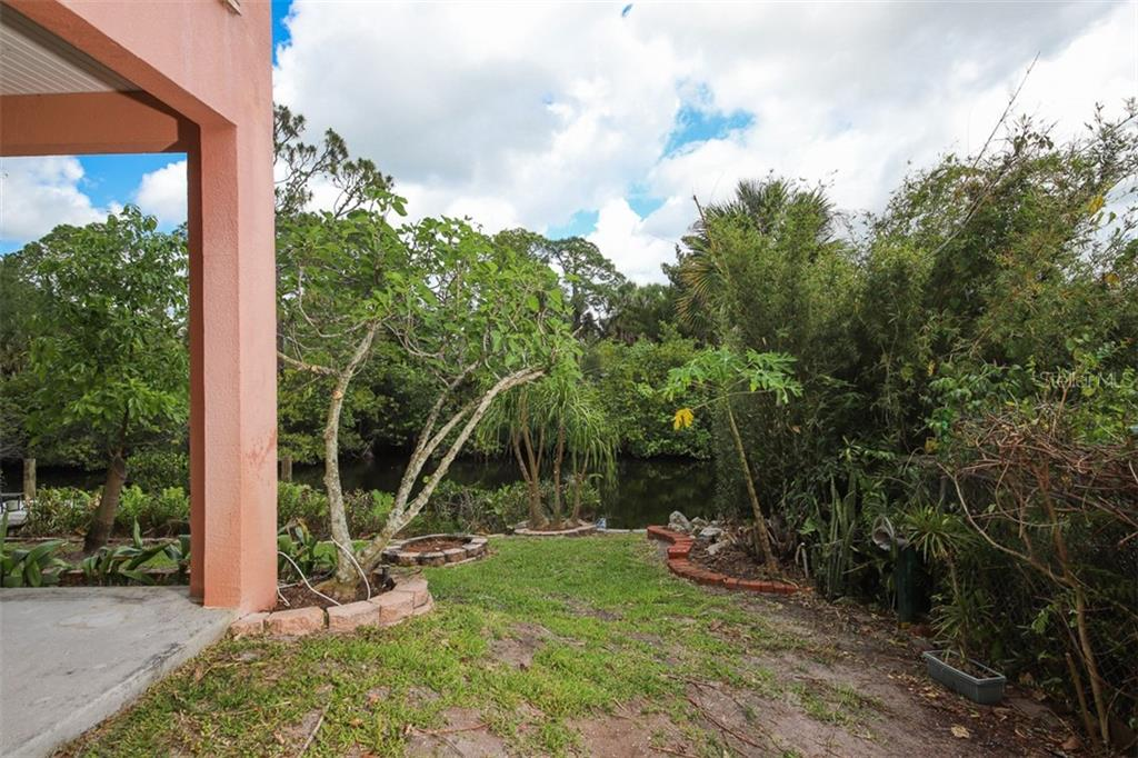 There's a THIRD garage door leading to the back of the home as well! - Single Family Home for sale at 9033 Allapata Ln, Venice, FL 34293 - MLS Number is D6106356