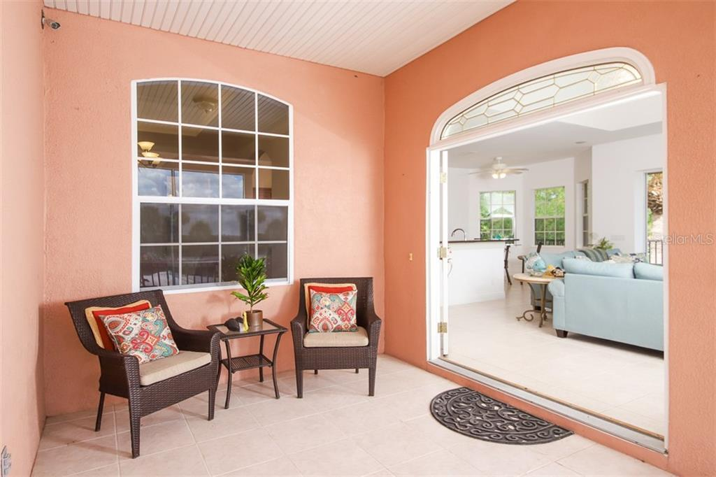 Double entry door.  Elevator is a smooth ride to the first level / garage. - Single Family Home for sale at 9033 Allapata Ln, Venice, FL 34293 - MLS Number is D6106356