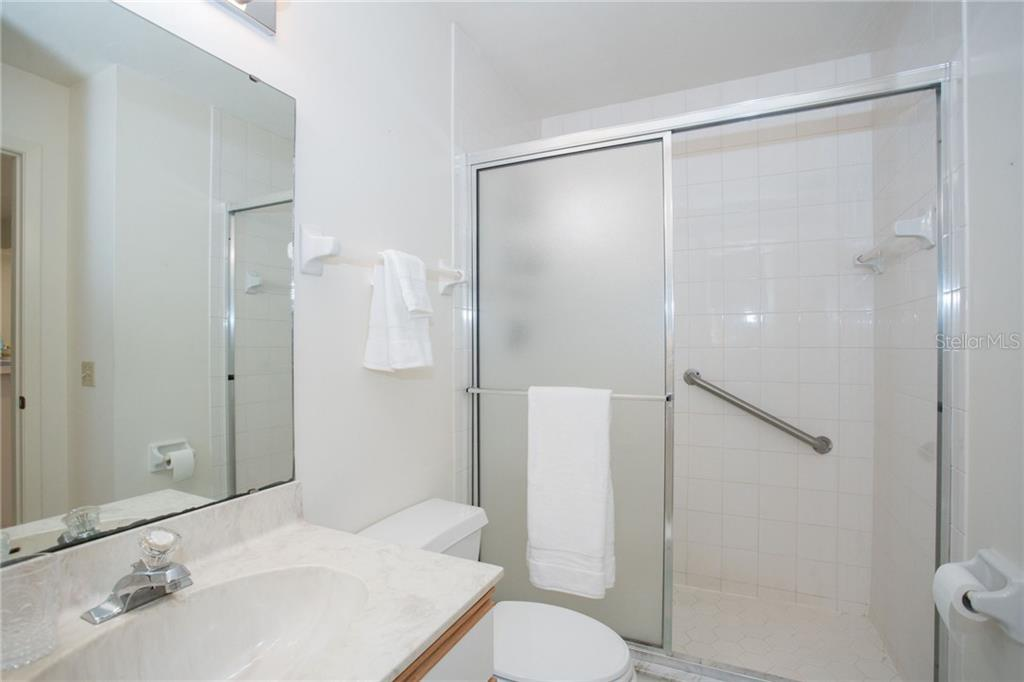 Guest bathroom with direct access from the 2nd bedroom, allowing your guests increased privacy. - Condo for sale at 6800 Placida Rd #271, Englewood, FL 34224 - MLS Number is D6106459