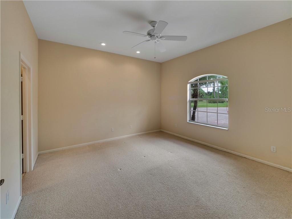 One of the guest bedrooms, all are a nice size. - Single Family Home for sale at 13283 Eisenhower Dr, Port Charlotte, FL 33953 - MLS Number is D6107998