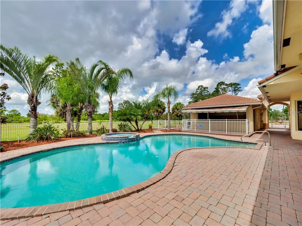 Pool area leads to outdoor kitchen area and guest house - Single Family Home for sale at 13283 Eisenhower Dr, Port Charlotte, FL 33953 - MLS Number is D6107998