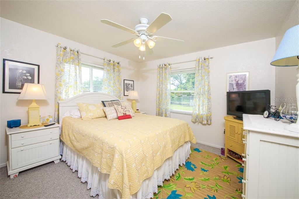 guest bedroom with views of pool - Single Family Home for sale at 913 Tropical Ave Nw, Port Charlotte, FL 33948 - MLS Number is D6108061