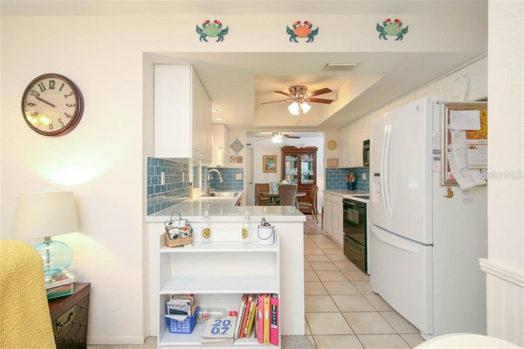 view of kitchen from family room - Single Family Home for sale at 913 Tropical Ave Nw, Port Charlotte, FL 33948 - MLS Number is D6108061