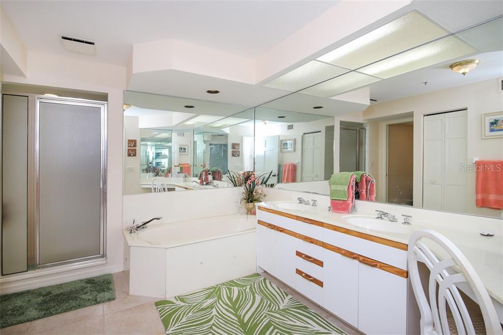 Master Bath with separate shower, jetted tub, dual sinks & separate commode area - Condo for sale at 11000 Placida Rd #2301, Placida, FL 33946 - MLS Number is D6108434