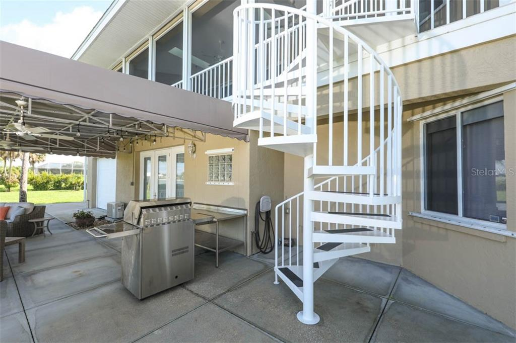 Spiral Stairs to Back Courtyard - Single Family Home for sale at 1636 New Point Comfort Rd, Englewood, FL 34223 - MLS Number is D6108467