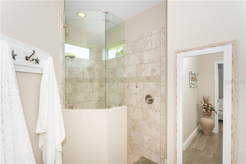 Master Bathroom Shower - Single Family Home for sale at 130 Jade St, Rotonda West, FL 33947 - MLS Number is D6108653