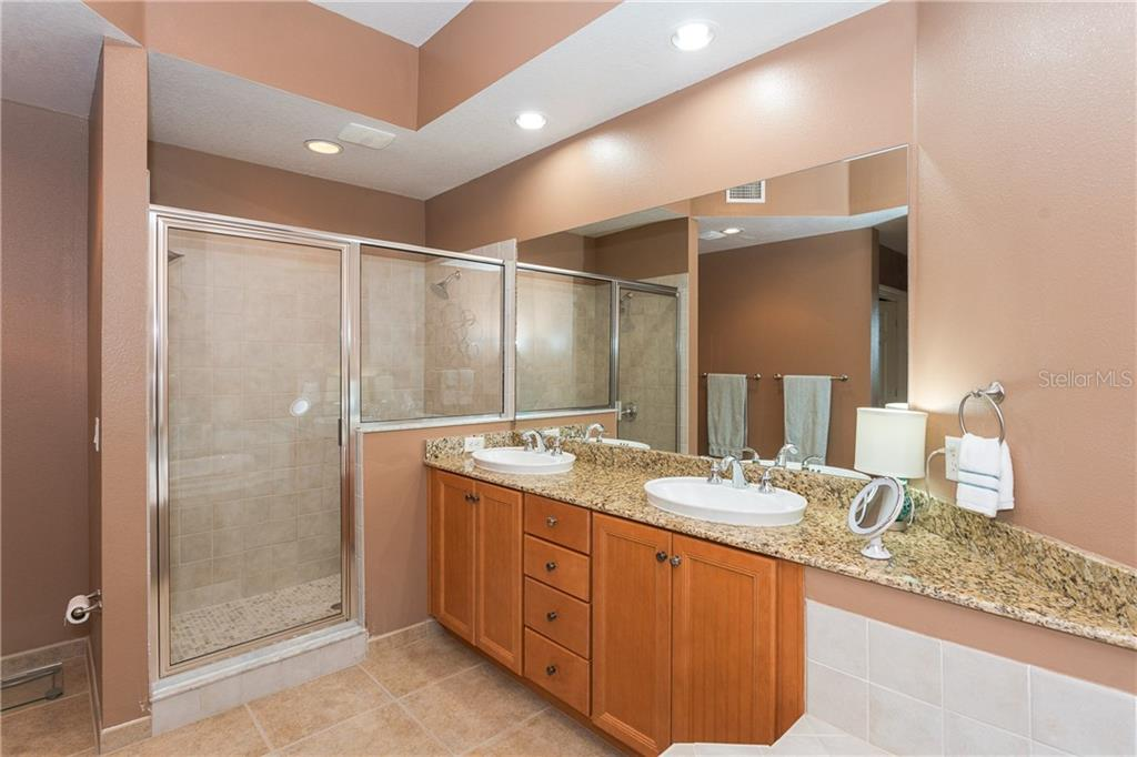 Master Bath Walk In Shower and dual vanity sinks - Condo for sale at 8561 Amberjack Cir #202, Englewood, FL 34224 - MLS Number is D6109771