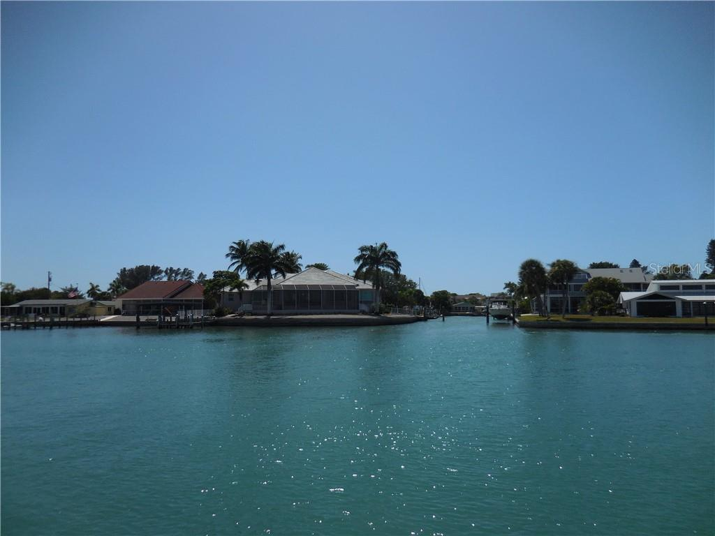 Boating Activity on Waterside of Home! - Single Family Home for sale at 185 Sabal Ln, Englewood, FL 34223 - MLS Number is D6110218