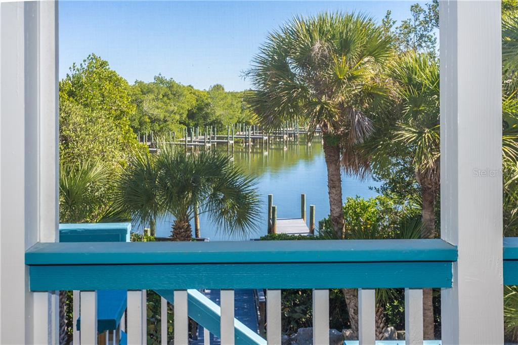 View of Canal from Rear Deck. - Single Family Home for sale at 540 N Gulf Blvd, Placida, FL 33946 - MLS Number is D6110801