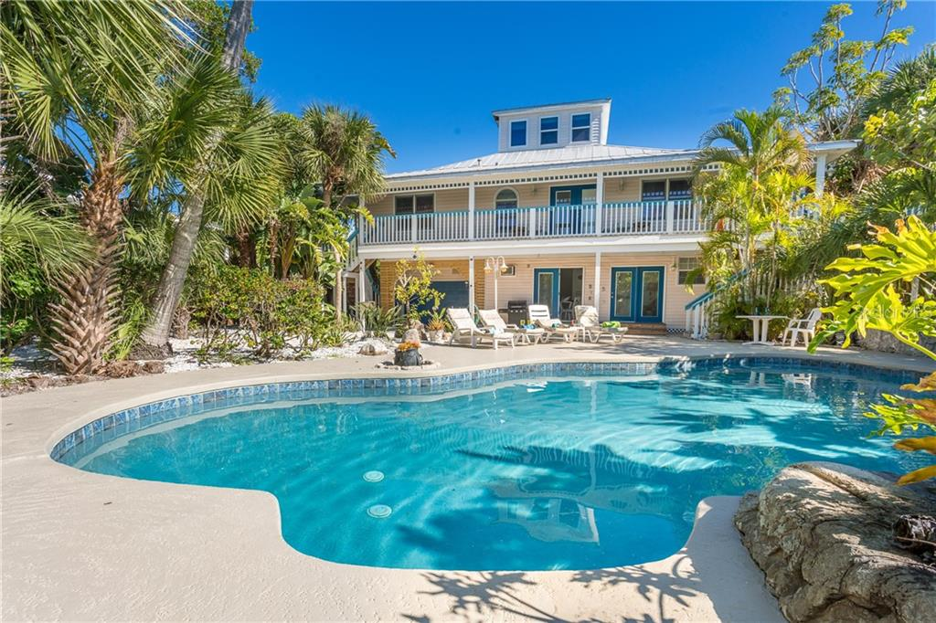 Pool, Pool Deck and Home. - Single Family Home for sale at 540 N Gulf Blvd, Placida, FL 33946 - MLS Number is D6110801
