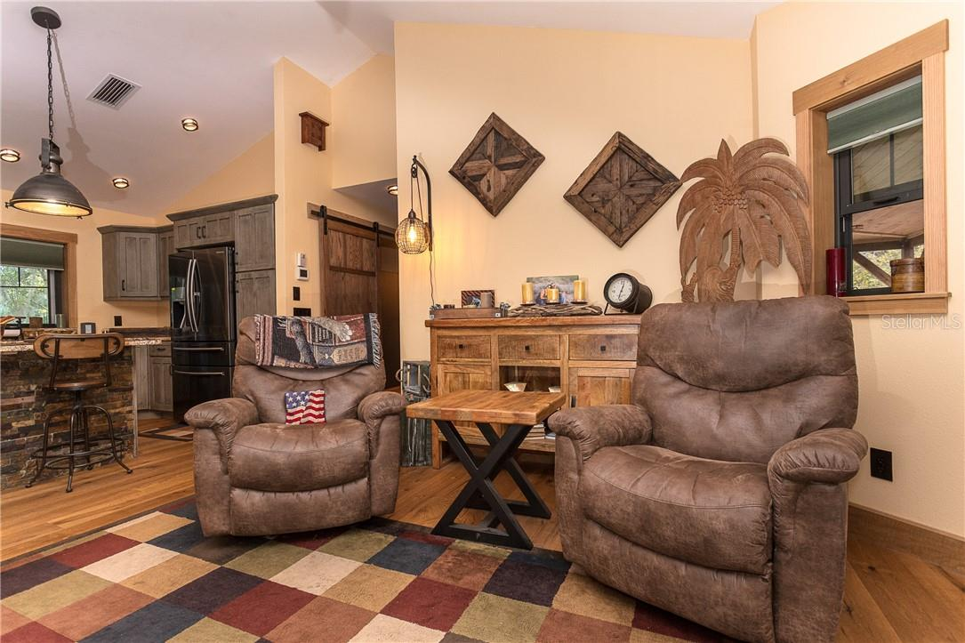 Living area-Kitchen - Single Family Home for sale at 1199 Seahorse Ln, Englewood, FL 34224 - MLS Number is D6110877